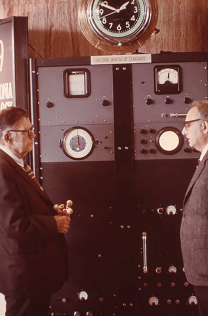 Condon (left) and Lyons (right) with Atomic Clock on 25th anniversary
